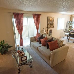 Model unit living room furnished in a contemporary style.